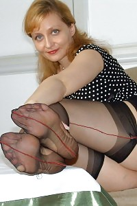 Kirsty Having Fun By Spreading And Closing Her Curvy Legs In Stockings