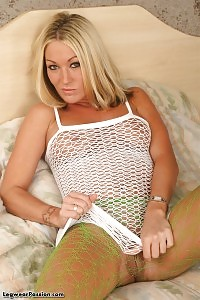 Take A Sit And Look As She Give You A Closeup Pictures Of Her Green Pantyhose And Dildo In Pussy