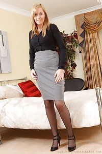 Foxy Blonde Demonstrates Her Astonishing Legs As She Teases Off After A Bad Day In The Office.